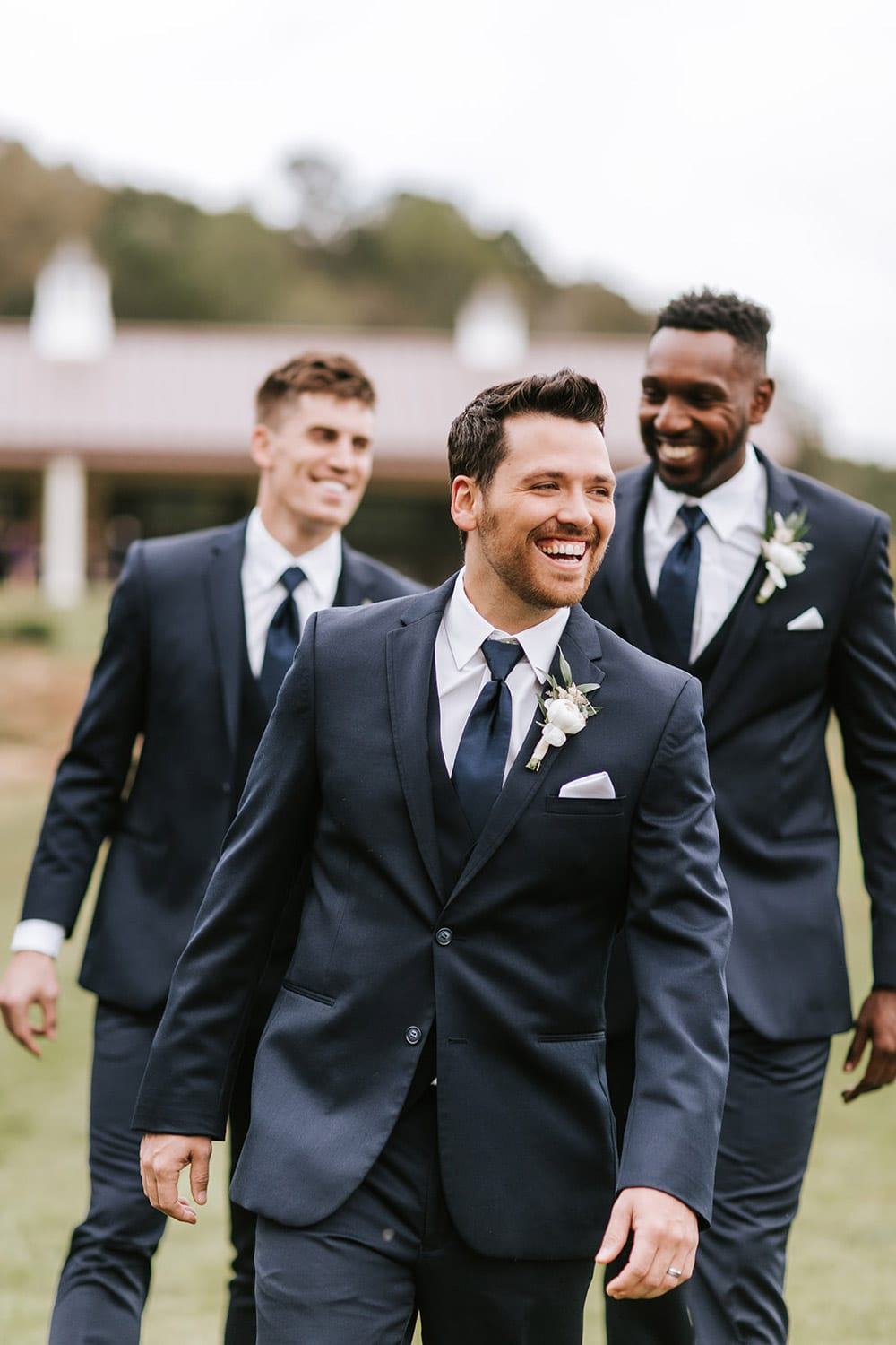 Groomsmen walking outside