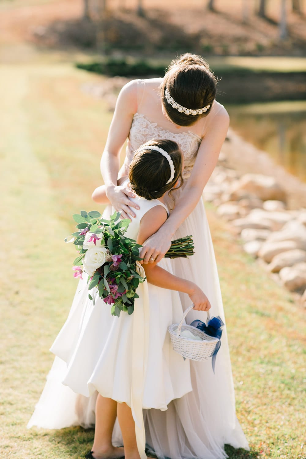 Bride holds flower girl