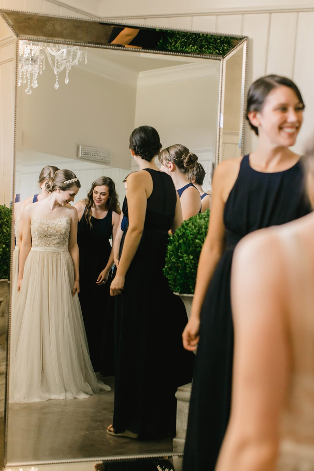 Bride gets ready in the mirror