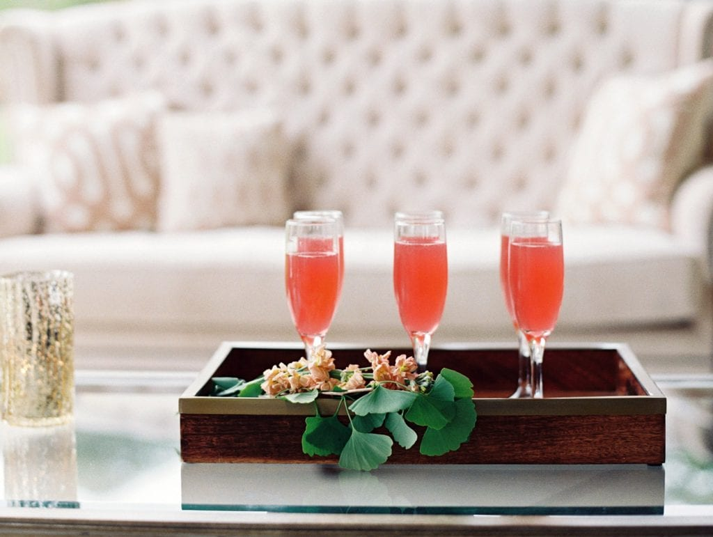 Red cocktails on glass table