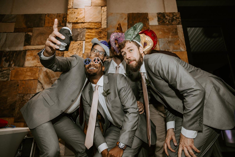 Groomsmen posing in photobooth