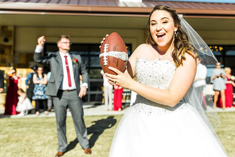 Bride throws football outside