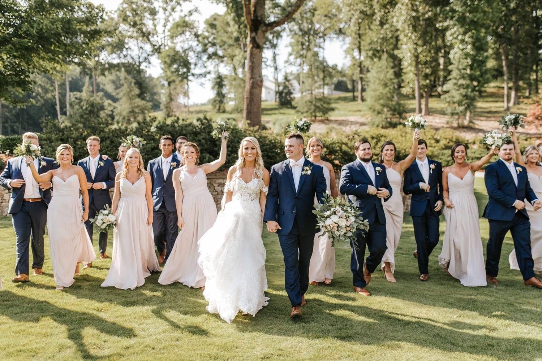 Bridal party walks outside