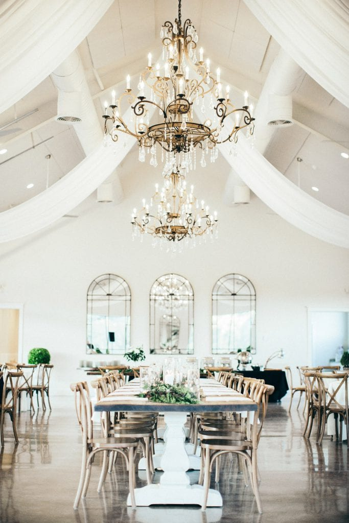 Dinner table and chandeliers