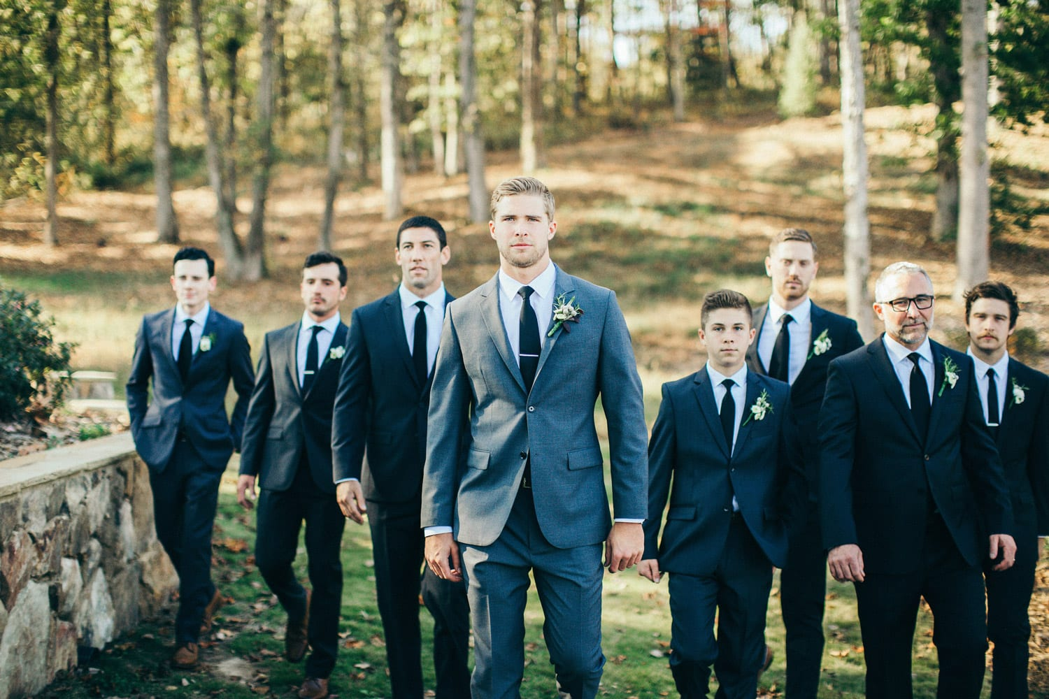 Groom and groomsmen walk outside