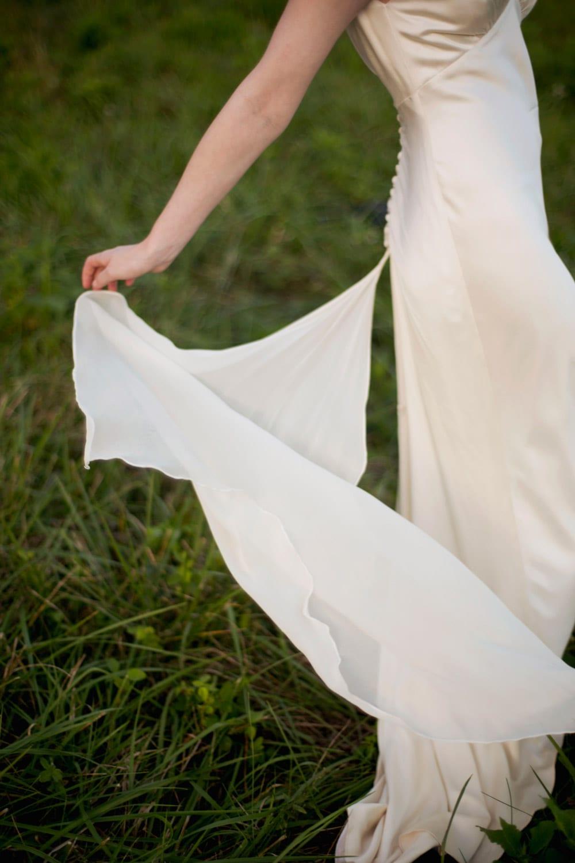 Bride twirls wedding dress outside