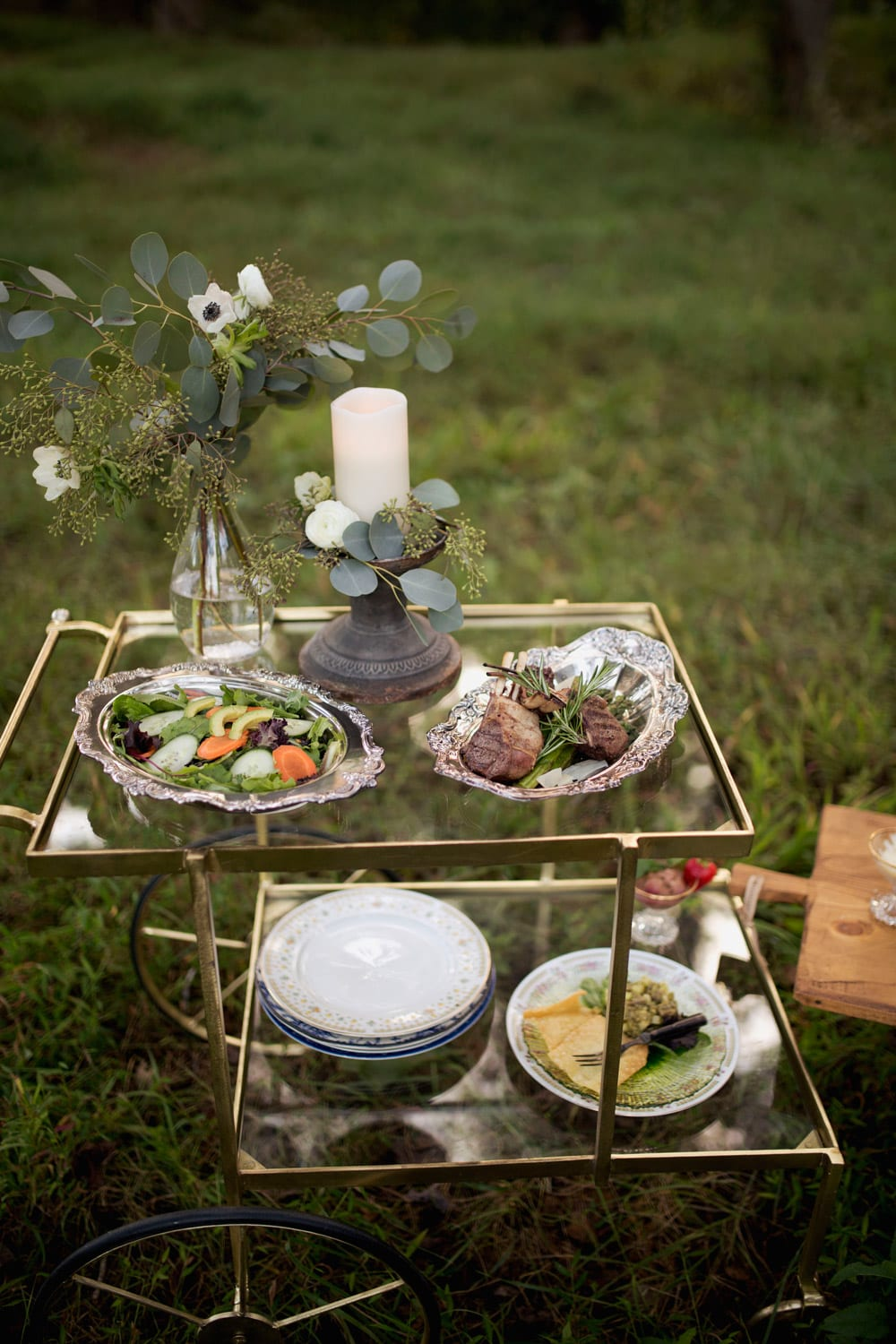 Glass table with food set out in the woods