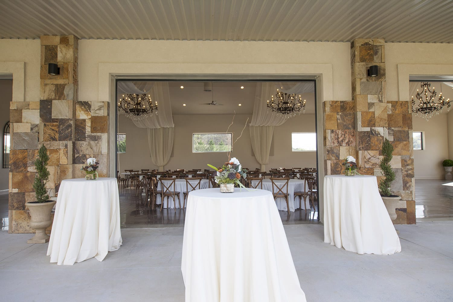 Reception hall porch with open windows and high boy tables
