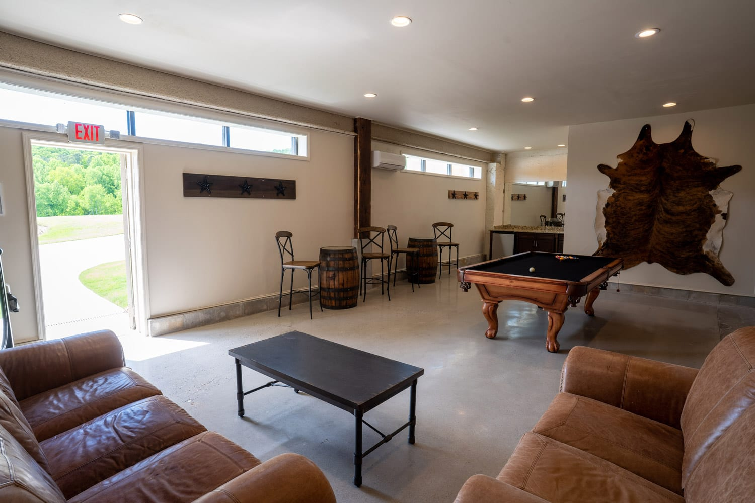 Groom's room with couches and billiards table