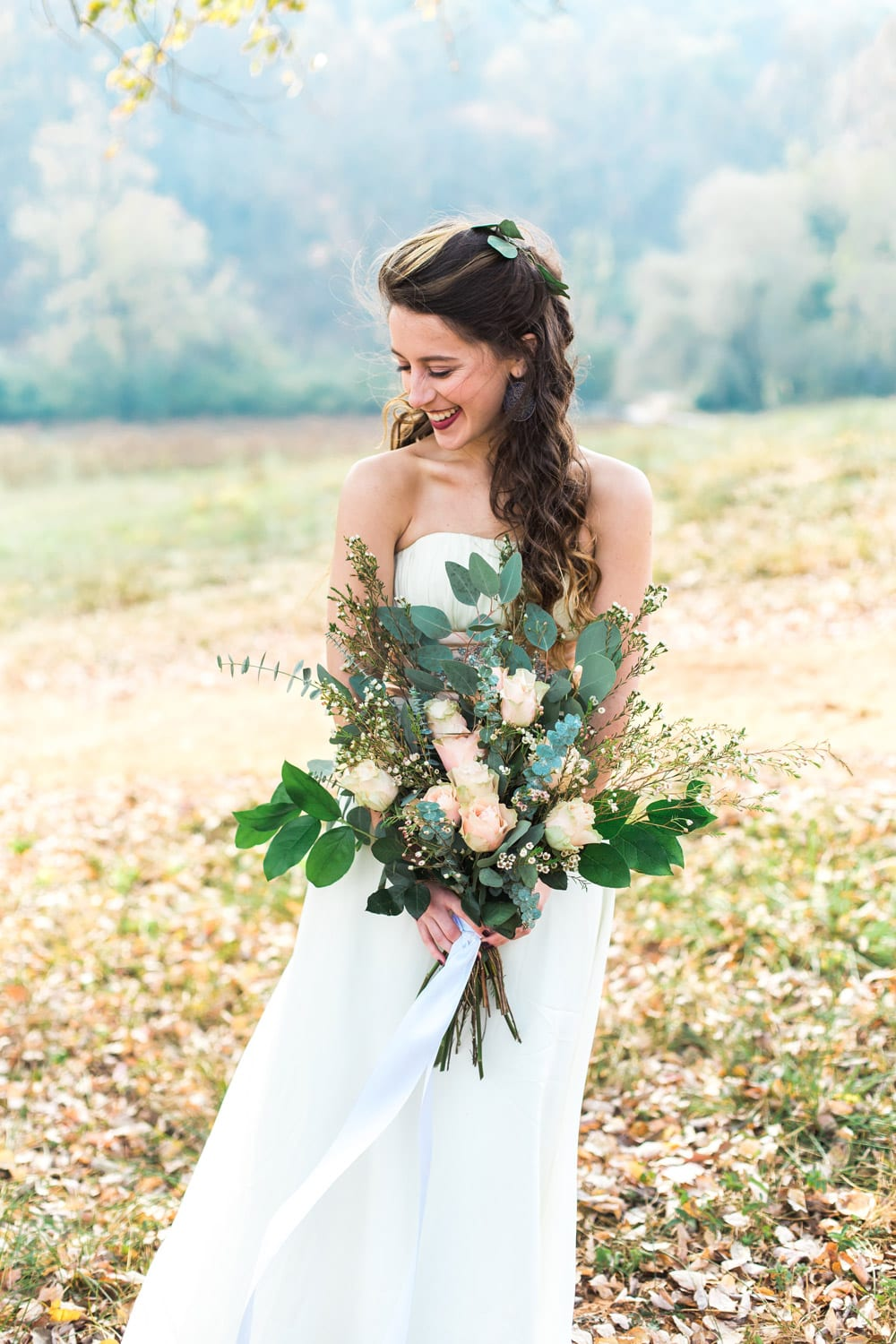 Bride poses outside with flowers