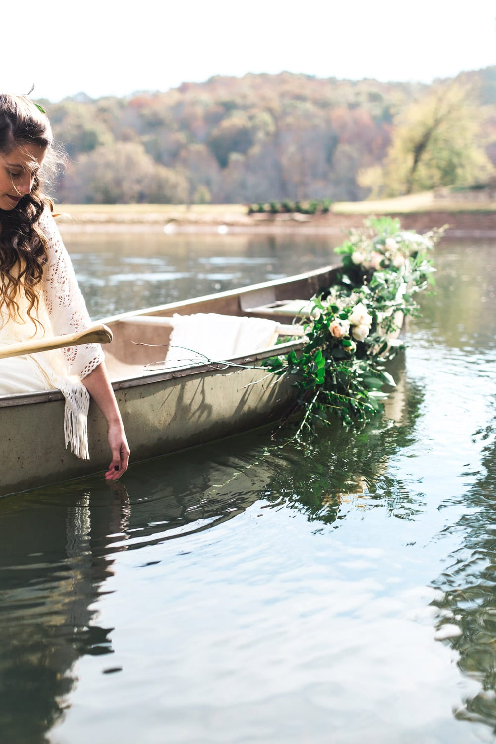 Bride rides boat on the water