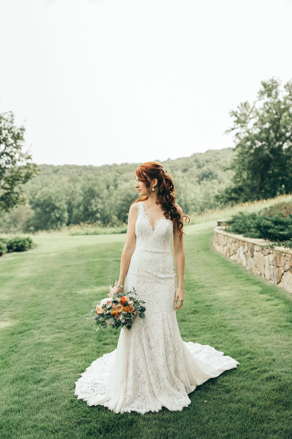 Bride stands outside with flowers
