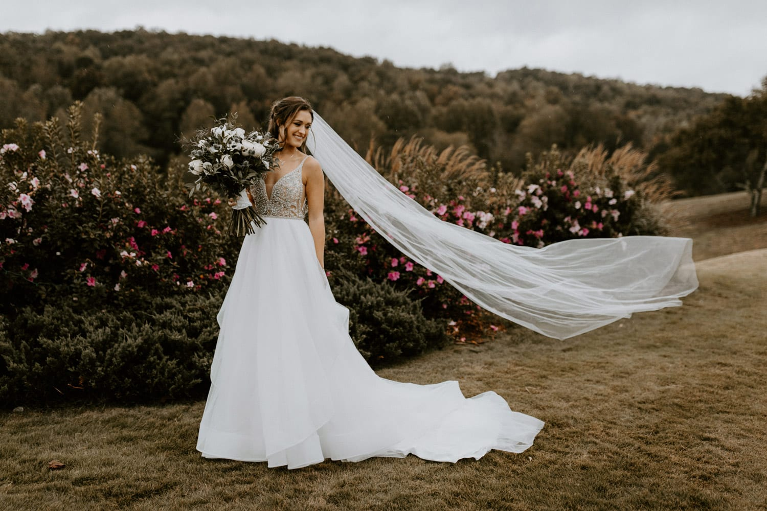 Bride with flowers outside in wedding dress