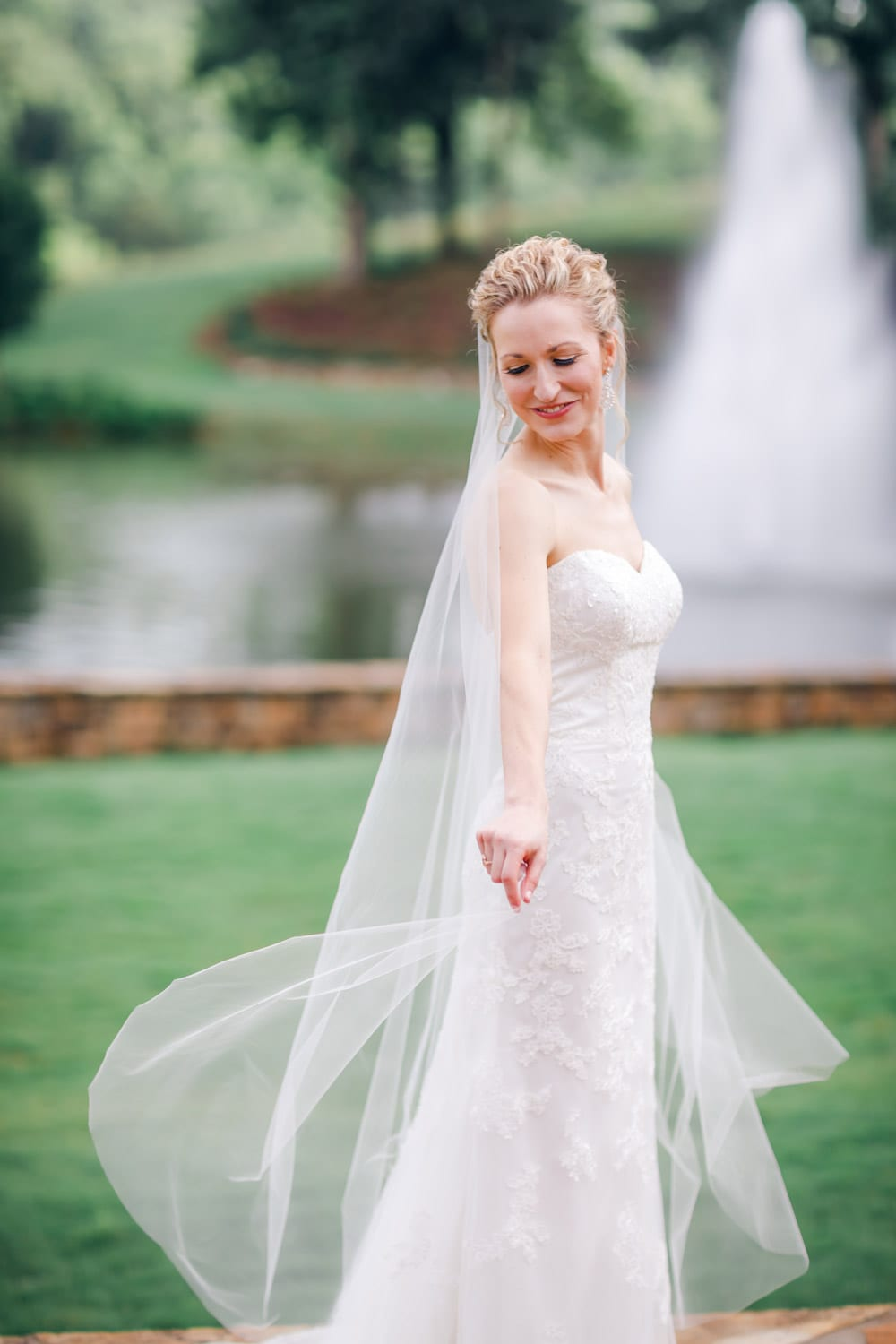 Bride twirls outside in front of fountain