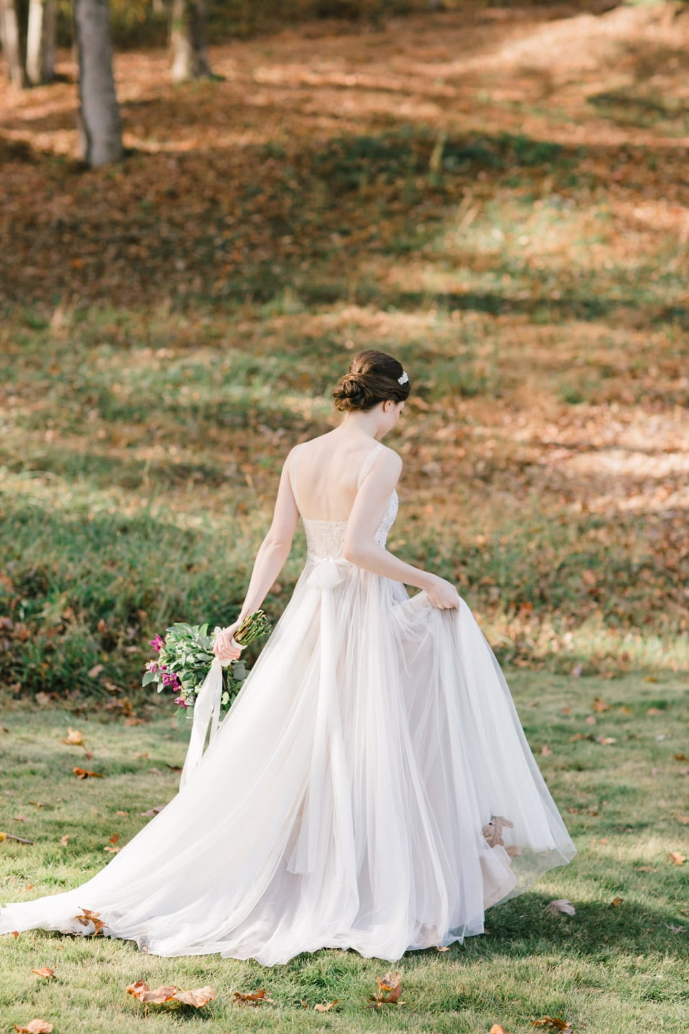 Bride walks outside with flowers
