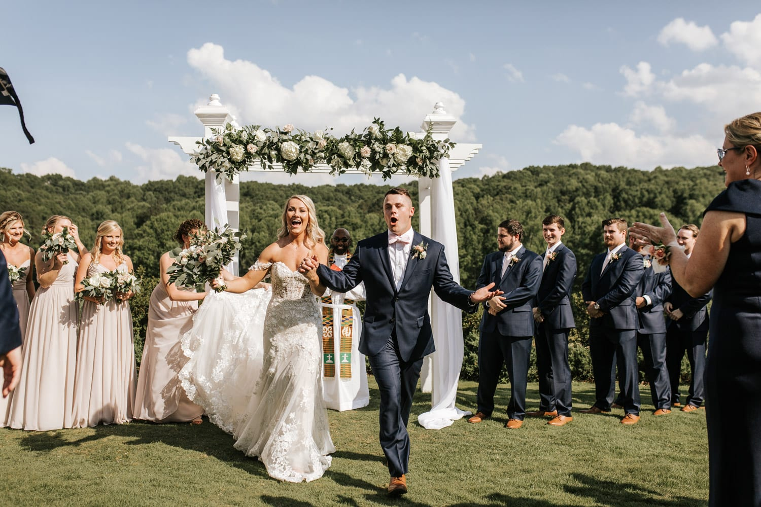 Bride and groom celebrate down the aisle