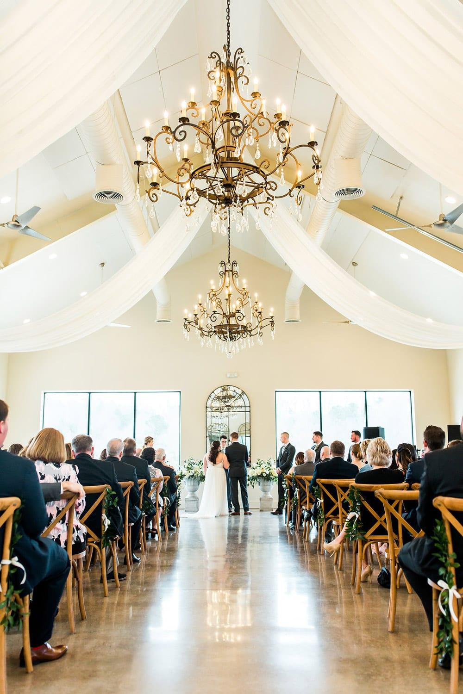 Indoor ceremony with chandeliers