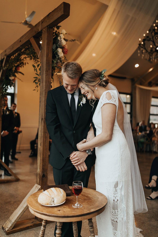 Bride and groom do communion
