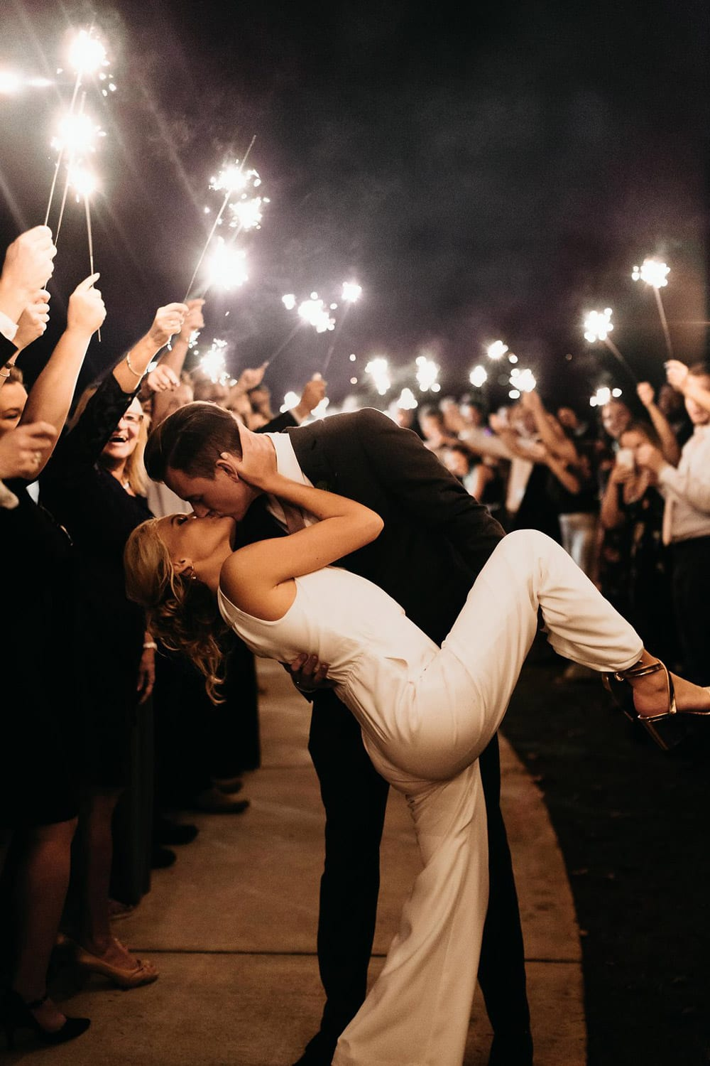 Groom kisses bride during send-off