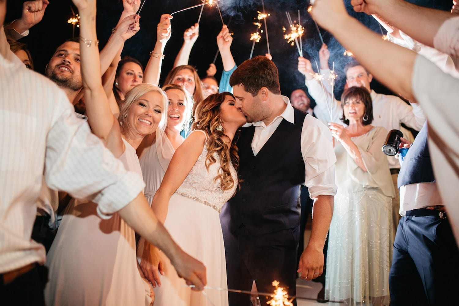 Bride and groom kiss during send-off