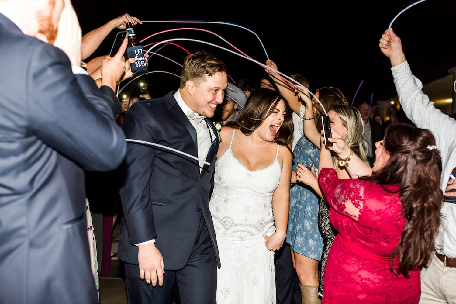 Bride and groom send-off with stringers